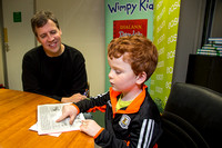 "Author Jeff Kinney  listens to his book ""Diary of a Wimpey Kid"" being read in Irish"
